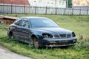 Junk Car in Lawn