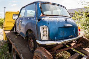 Blue junker car on flat bed